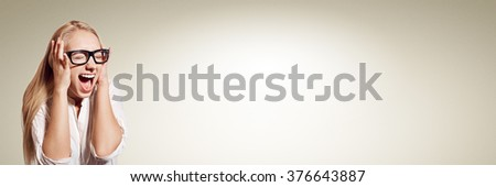 Closeup portrait stressed, frustrated shocked business woman pulling hair out yelling screaming temper tantrum isolated. Negative human emotion facial expression reaction. Free space for text. - stock photo