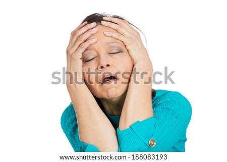 Closeup portrait, stressed, senior mature woman, employee, worker, teacher having bad migraine, headache, isolated white background. Negative human face expressions, emotions, reaction, attitude - stock photo