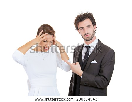 Closeup portrait stressed young couple going through relationship hard times isolated white background. Upset angry husband blaming his wife for wrong doing something woman has headache from screaming - stock photo