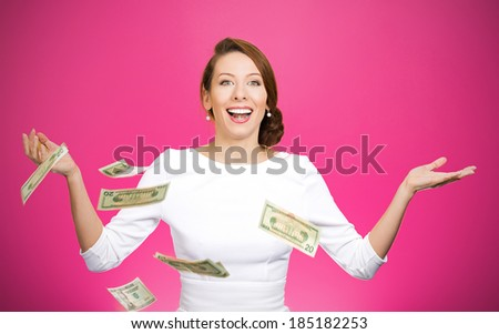 Closeup portrait super excited, laughing young woman who just won lots of money, trying to catch, throw dollar bills in air, isolated magenta background. Positive emotion, facial expression, feelings - stock photo