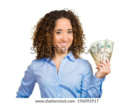 Closeup portrait super happy excited successful young business woman holding money dollar bills in hand, isolated white background. Positive human emotion, facial expression, feeling. Financial reward - stock photo