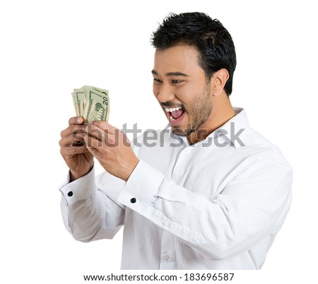 Closeup portrait, super happy excited successful young man holding money dollar bills in hand, isolated white background. Positive emotion facial expression feeling. Financial reward savings - stock photo
