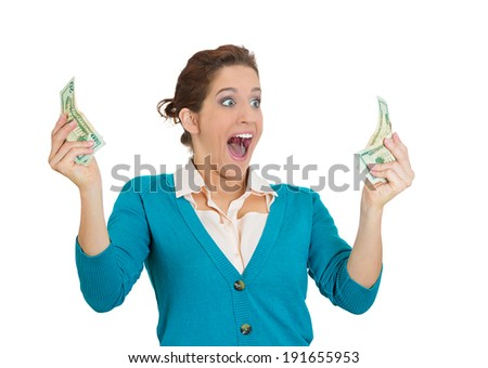 Closeup portrait super happy excited successful young woman holding money dollar bills in hand isolated white background. Positive emotion facial expression feeling reaction. Financial reward savings  - stock photo