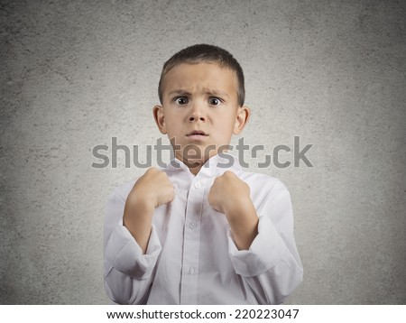 Closeup portrait surprised child boy getting unexpected attention from people asking you talking to, mean me? pointing fingers at himself isolated grey wall background. Human facial expression emotion - stock photo