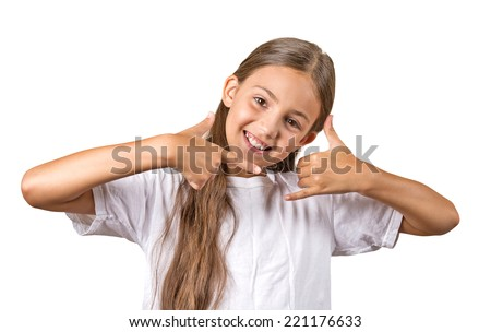 Closeup portrait  teenager girl making call me gesture sign with hand shaped like phone, isolated white background. Positive human emotions, face expressions, body language, communication - stock photo