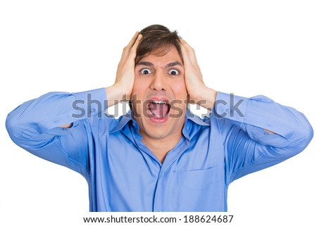 Closeup portrait, upset, frustrated, overwhelmed, stressed young man squeezing his head, going nuts, screaming, losing mind, isolated white background. Negative emotion facial expression feelings - stock photo