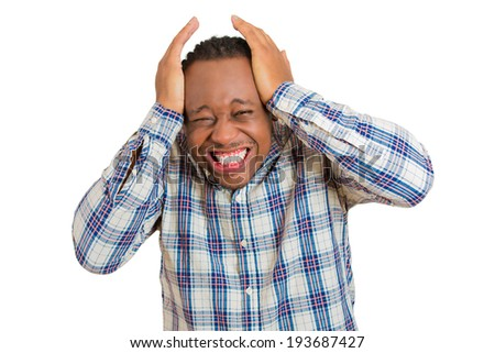 Closeup portrait upset, frustrated, overwhelmed, stressed young man squeezing his head, going nuts, screaming, losing mind isolated white background. Negative human emotions, facial expression feeling - stock photo