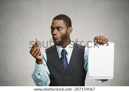 Closeup portrait upset man, guy says no to smoking, screaming at cigarette, holding notepad with blank paper copy space provided isolated black background. Healthy life choices. Passive smoking danger - stock photo