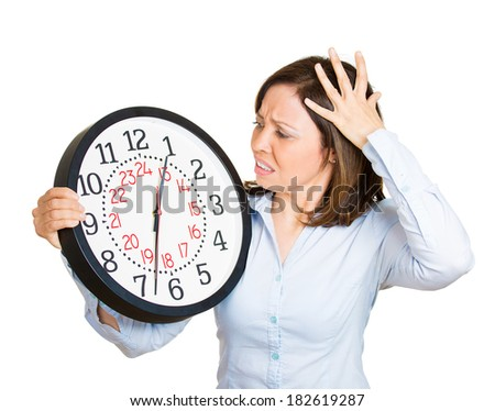 Closeup portrait woman, worker, holding clock looking anxiously, pressured by lack, running out of time, isolated white background. Human face expression, emotion, reaction, corporate life - stock photo