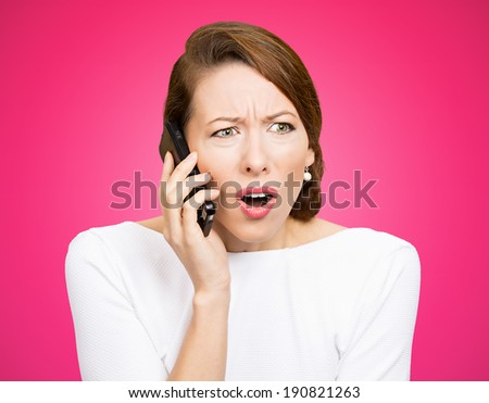 Closeup portrait young angry business woman, corporate employee talking on cell phone, having unpleasant, bad conversation, isolated pink background. Negative emotions, facial expressions, reaction - stock photo