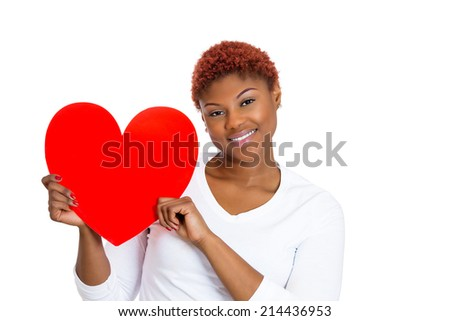 Closeup portrait young beautiful woman, happy joyful female in love holding red valentine heart looking at you, isolated white background. Positive human emotions, facial expressions, feelings - stock photo