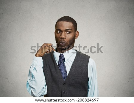 Closeup portrait, young business Man opening shirt to vent, it's hot, Unpleasant, Awkward Situation, Embarrassment. Isolated black, grey background. Negative Emotions, Facial Expression, Feelings - stock photo