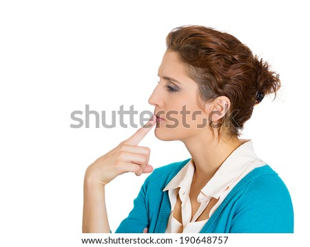 Closeup portrait young business woman thinking, daydreaming deeply about something, finger on lips looking sad, isolated white background. Human emotions, facial expressions, feelings, life reaction - stock photo