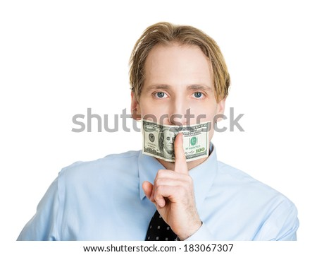 Closeup portrait young corrupt man in blue shirt with hundred dollar bill taped to mouth, showing shhh sign isolated white background. Bribery concept in politics, business, diplomacy. Life perception - stock photo