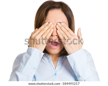 Closeup portrait young, coy woman closing eyes with hands can't see and hiding mouth wide open, isolated white background. See no evil concept. Negative emotion facial expression feelings - stock photo