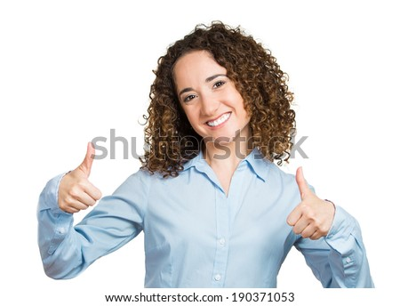 Closeup portrait, young, curly, brown hair woman, student being excited, giving thumbs up, isolated white background. Positive human emotions, facial expressions, feeling, signs, symbol, attitude - stock photo