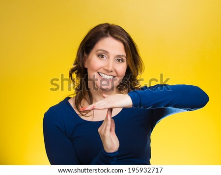 Closeup portrait, young, happy, smiling woman showing time out gesture with hands, isolated yellow background. Positive human emotions, facial expressions, feelings, body language, reaction, attitude - stock photo