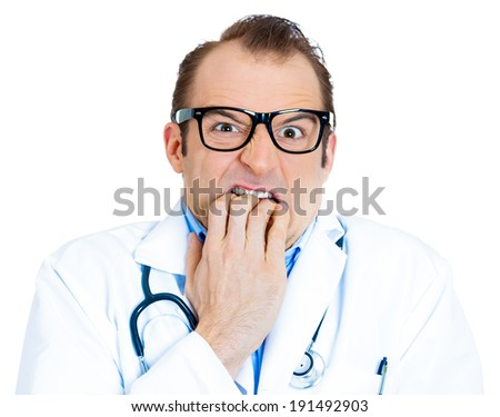 Closeup portrait young insecure male doctor, black glasses, biting his nails looking funny, scared craving something anxious isolated white background. Human facial expression emotion feeling reaction - stock photo