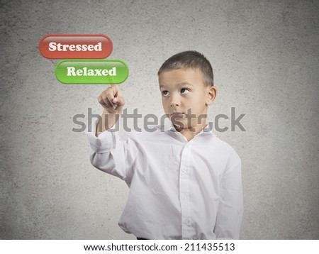 Closeup portrait young man picking touching with finger relaxed green button vs red stressed button on imaginary touch screen display isolated grey wall background. Emotion facial expression reaction - stock photo