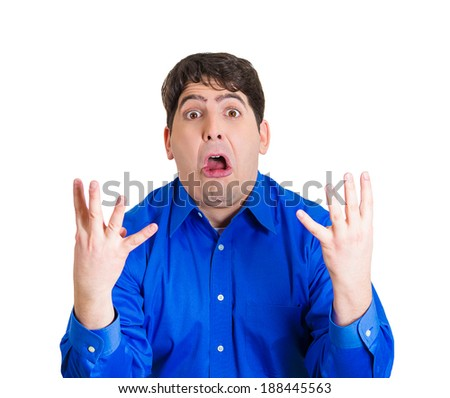 Closeup portrait, young man with hands in air, wide open mouth, just realized he made a huge error, having a panic attack, freaking out, isolated white background. Human emotion facial expression - stock photo