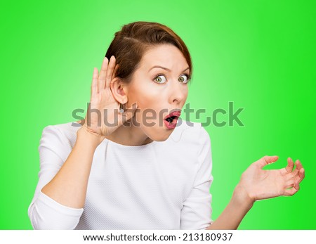 Closeup portrait young nosy woman hand to ear gesture trying carefully intently secretly listen in on juicy gossip conversation news privacy violation isolated green background. Human face expression - stock photo