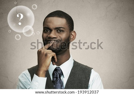 Closeup portrait young, puzzled business man thinking, deciding deeply about something finger on lips looking confused isolated black background with question bubble. Emotion facial expression feeling - stock photo