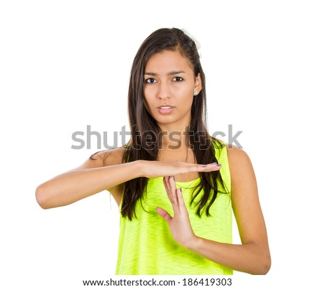 Closeup portrait, young serious woman showing a time out gesture with hands, isolated  white background. Negative human emotion facial expression feelings, body language - stock photo