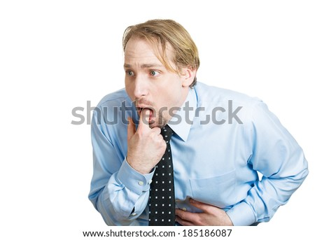 Closeup portrait, young sick,funny looking business man sticking finger in mouth about to throw up, show something sucks, isolated white background. Negative human emotion, feelings, facial expression - stock photo