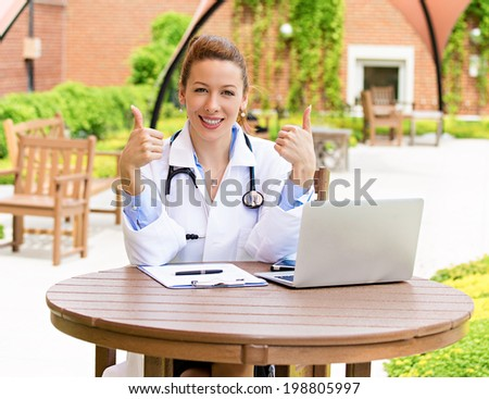 Closeup portrait young, smiling, confident female doctor with stethoscope, healthcare professional giving thumbs up gesture isolated background hospital campus. Patient visit care. Positive emotion - stock photo