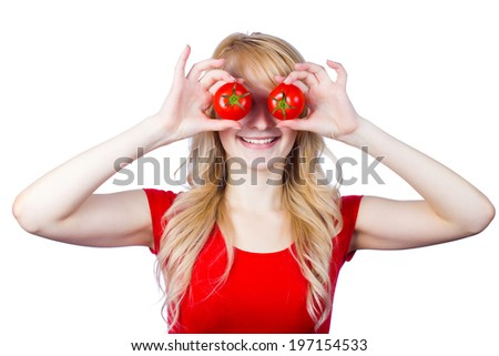 Closeup portrait young, smiling, happy woman holding, showing tomatoes over her eyes, laughing. Healthy lifestyle people. Funny image excited girl. Positive human emotion, facial expressions, feelings - stock photo