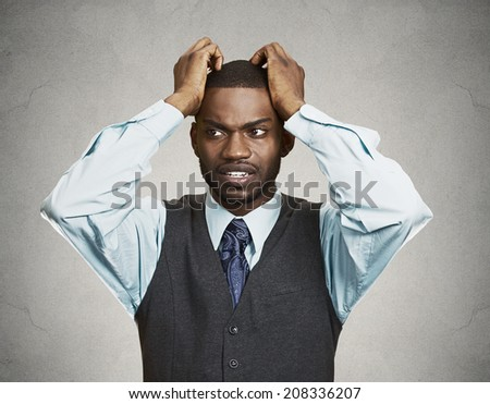 Closeup portrait, young, stressed, unhappy executive man with hands on temples, head about to explode, almost having nuclear meltdown, isolated grey color background. Warhol style picture - stock photo