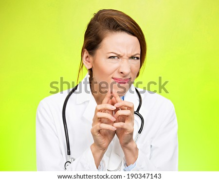 Closeup portrait, young suspicious, skeptical crazy female doctor, psychiatrist looking funny, pessimistic, craving, anxious, isolated, green background. Human facial expressions, emotions, feelings - stock photo