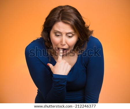 Closeup portrait young woman, annoyed, frustrated fed up sticking fingers in her throat showing she is about to throw up. Case anorexia nervosa, Isolated orange background. Negative face expression - stock photo