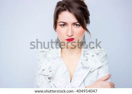 Closeup pose of an angry woman screaming in the white elegant jacket - stock photo