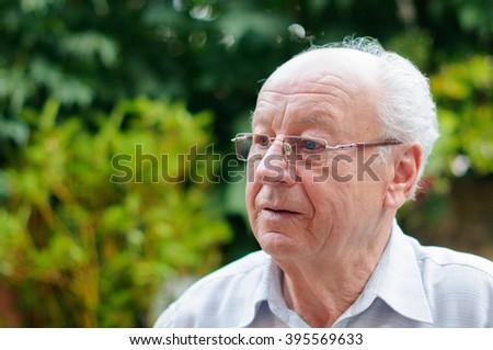 Closeup profile on a senior man - stock photo