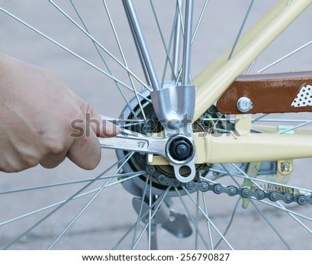 Closeup  repairing a bike - stock photo