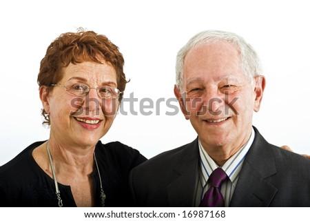 closeup senior couple smiling isolated on white - stock photo