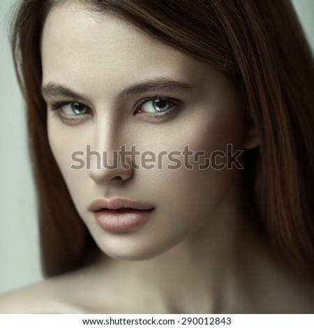 Closeup sensual beauty portrait of young beautiful red-haired model. Skin care. - stock photo