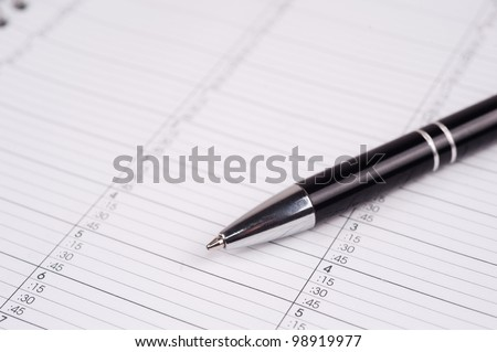 closeup shot of a pen on a calendar page - stock photo