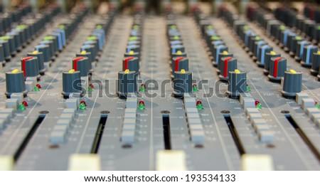 closeup shot of audio mixer in recording studio - stock photo