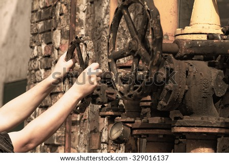 Closeup shot of big rusted valve industrial site - stock photo