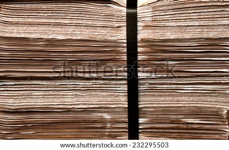 Closeup  shot of  daily newspapers stacked in a heap / Daily newspapers stacked in a heap/ Closeup  shot of  daily newspapers stacked in a heap (background,  closeup, newspapers) - stock photo
