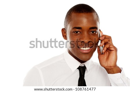 Closeup shot of executive communicating on cellphone against white background - stock photo
