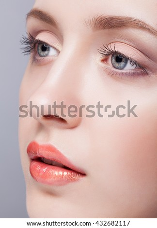 Closeup shot of female blue colour eyes  with day makeup - stock photo