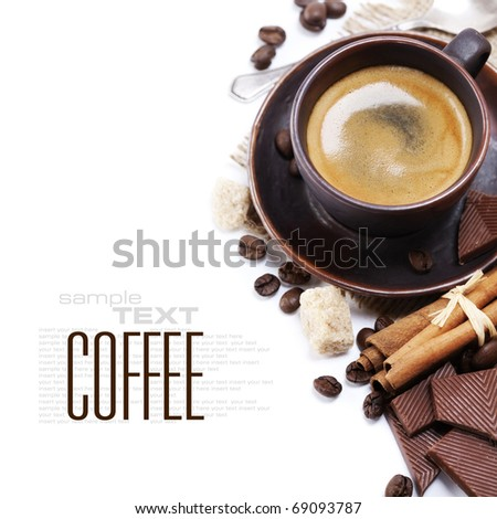 Closeup shot of freshly prepared cup of italian espresso with cinnamon, coffee beans, brown sugar and chocolate over white (with sample text) - stock photo