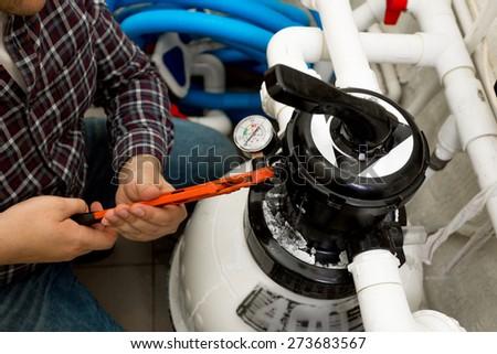 Closeup shot of handyman installing manometer on high pressure system - stock photo