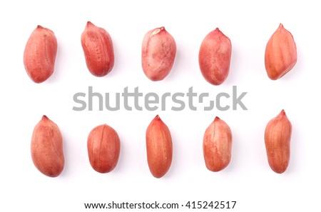 Closeup shot of peanut kernels isolated on white background. - stock photo