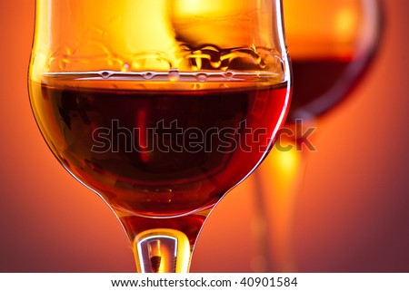 closeup shot of red drink in glass - stock photo