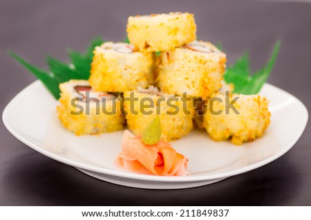 Closeup shot of six delicious sushi rolls with ginger and wasabi decoration selective focus - stock photo