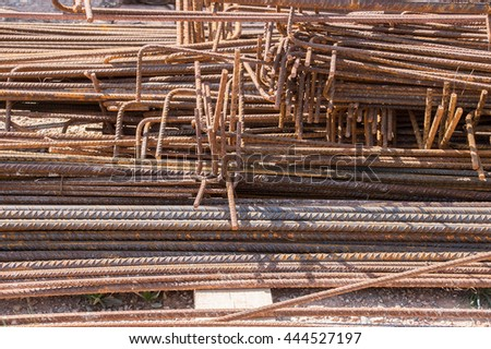Closeup shot of twisted steel construction materials in a construction site with bar iron - stock photo